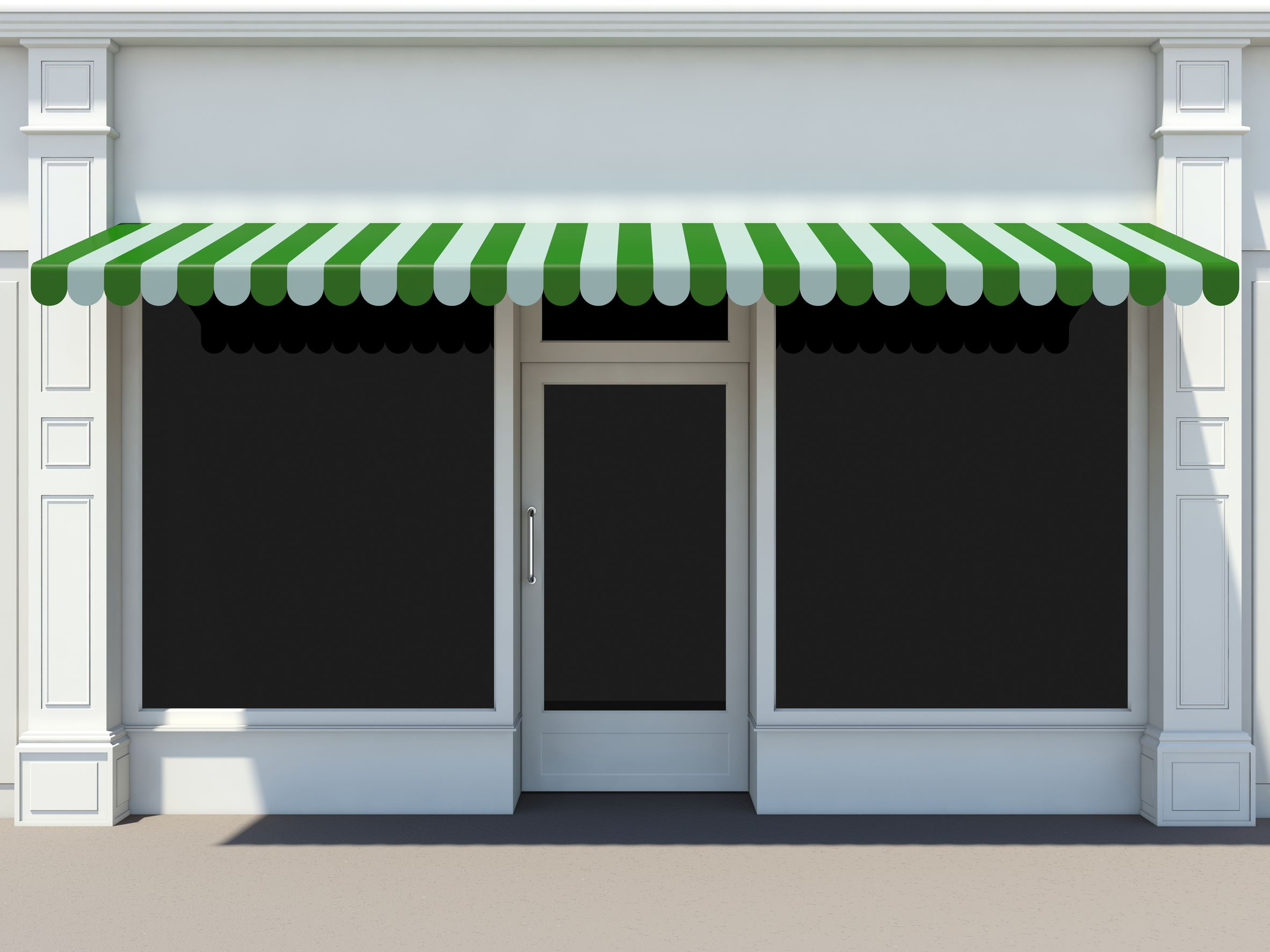 19523714 - shopfront in the sun - classic store front with green awnings
