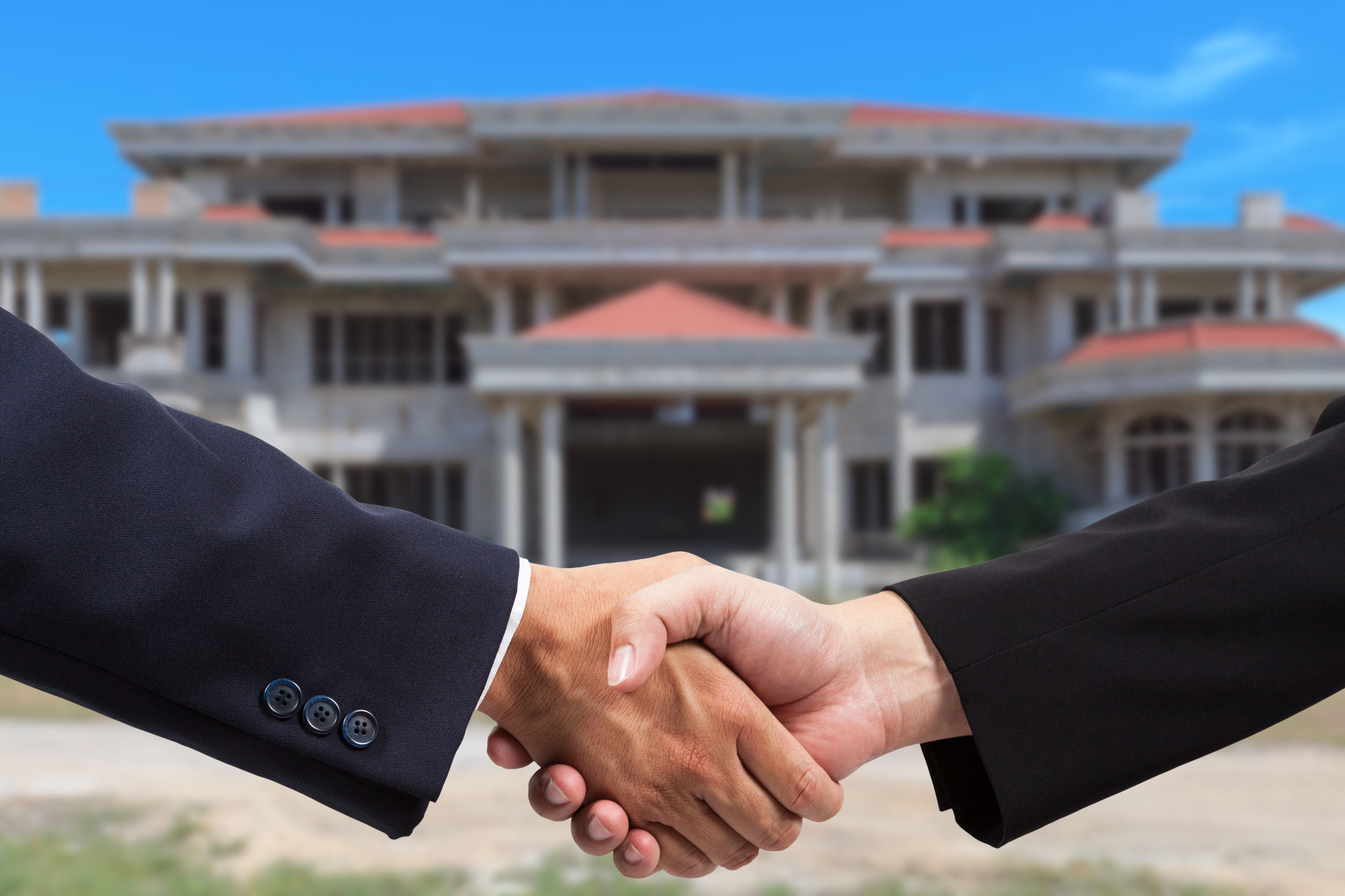 Businessman handshake for real estate business