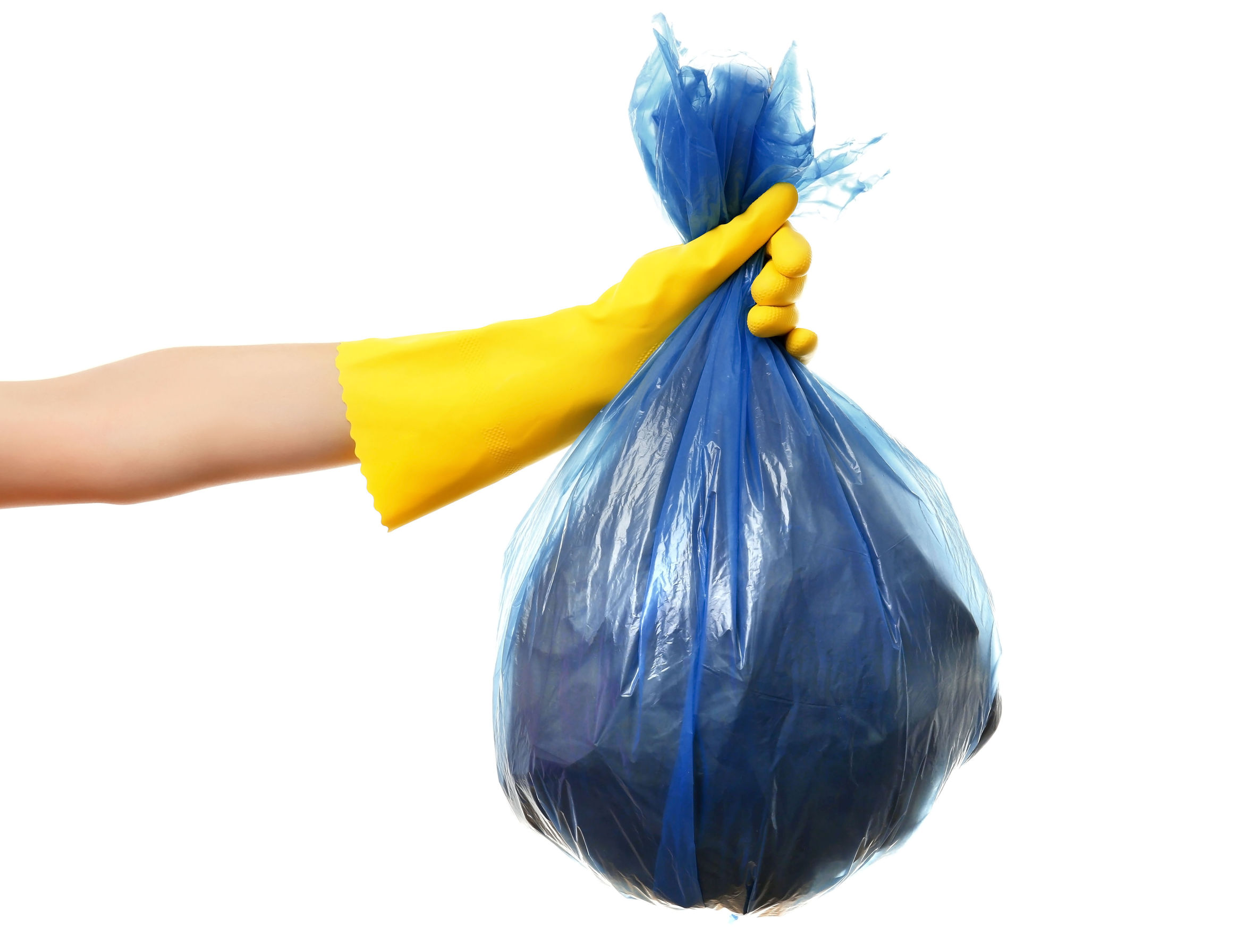 Female hand holding garbage bag, isolated on white